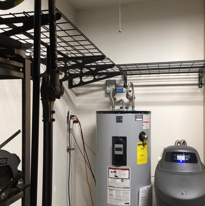 L-shaped configuration over the water heater / water softener to make use of dead space. Photo by Thomas Tran