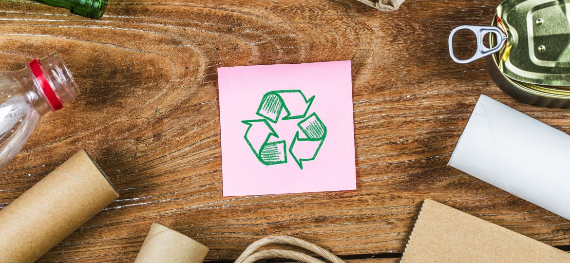 waste recycling eco symbol with garbage disposal on wooden table
