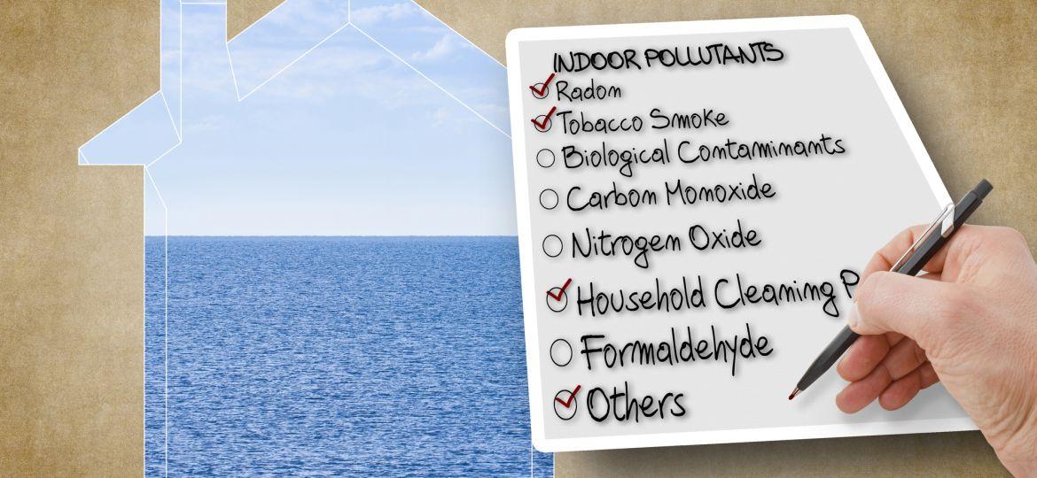 Hand write a check list of indoor air pollutants - concept image against the purity of a natural background